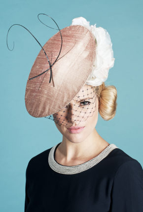 dusky pink silk with black veiling, black quills and a champagne rose
