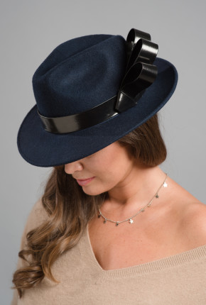 navy felt trilby with black patent leather trim and bow