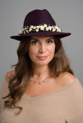 Purple felt trilby with white and purple rose trimming