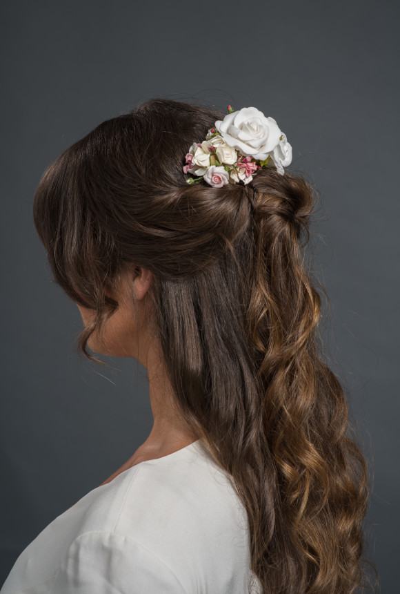 varying sizes of white and pink roses on a hairclip