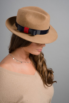 Camel trilby with patent leather trim and bow