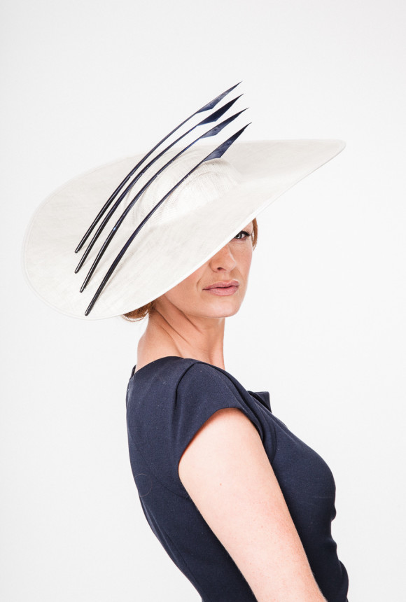 Large sinamay pearl grey hat with 4 striking navy goose spear feathers