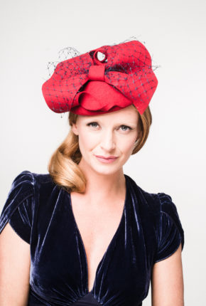 red felt beret with a bow and navy veiling