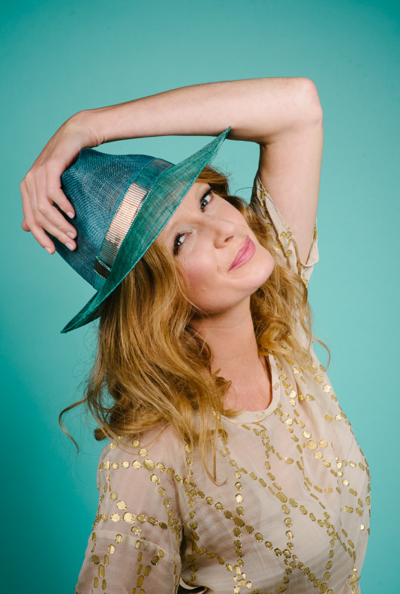 Teal sinamay trilby with gold metalic trim