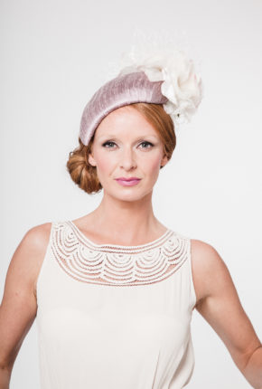 lilac silk covered headpiece with two blush pink and ivory roses and ivory waffle vieling
