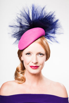 fuchsia felt headpiece with a navy crinoline pouf