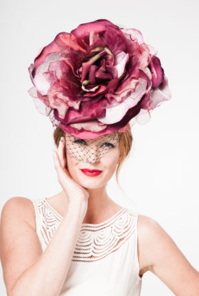 Large silk rose in antique burgundy with racing green birdcage veil