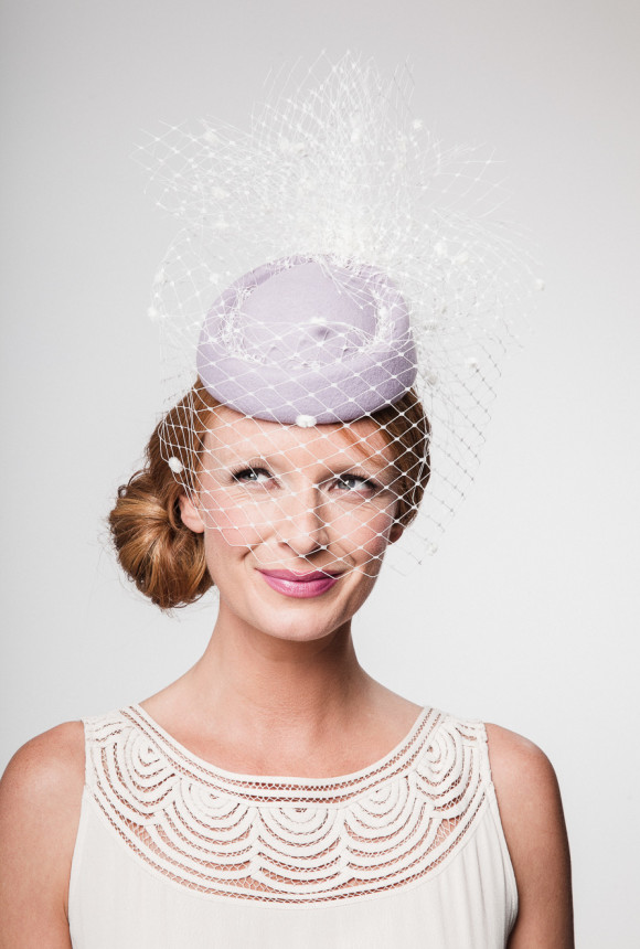 pale lilac felt rolo pillbox covered in ivory spot veiling