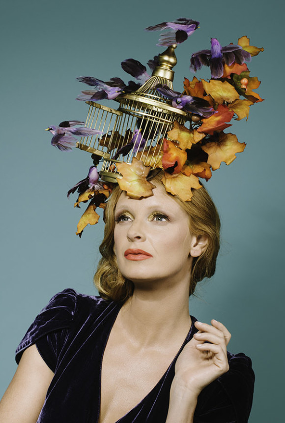 A birdcage headpiece combining autumn leaves, lilac birds and a golden birdcage