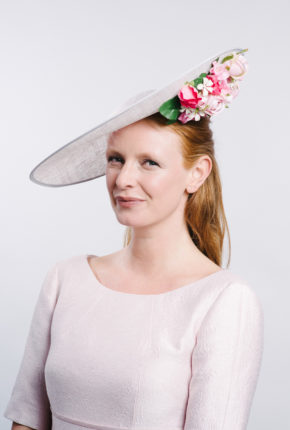 large silver sinamay hat with pink flowers