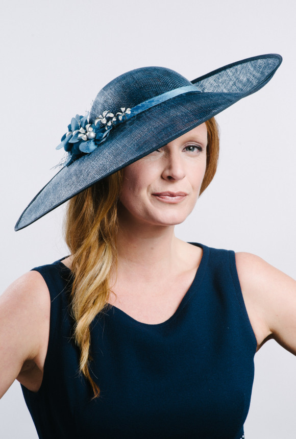 Navy wide brimmed hat with silk and pearl flowers