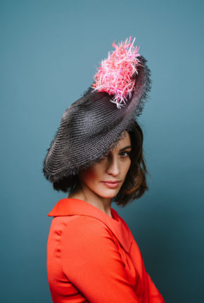 Black frayed saucer. Orange and pink feathers