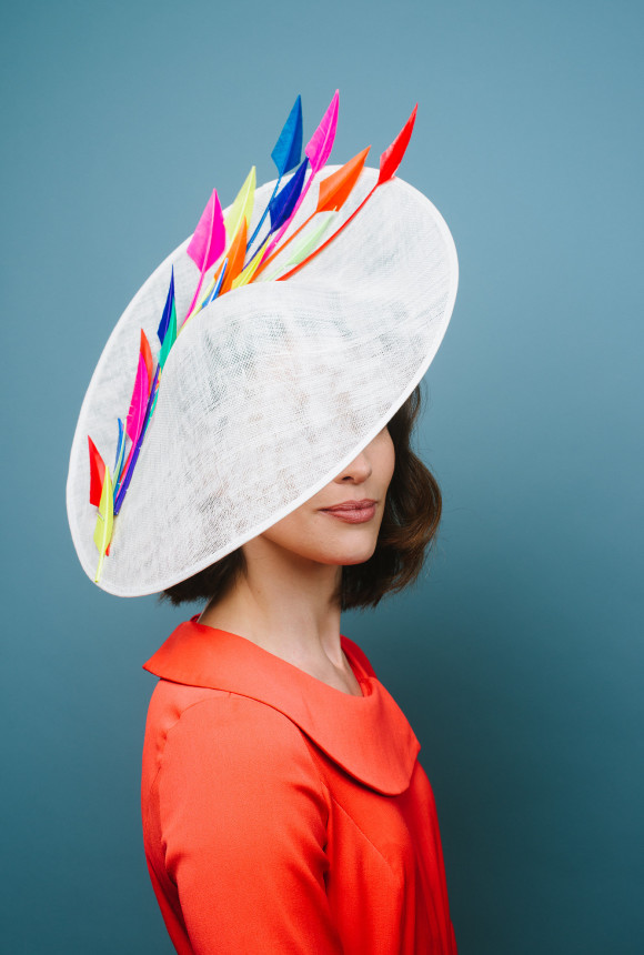 multi coloured feathers on ivory saucer